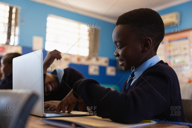 Student using laptop in the classroom at school