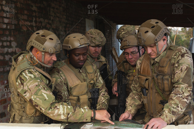 Military men discussing the map during military training