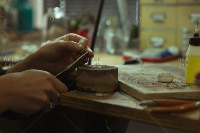 Close-up of jewelry designer making jewelry in workshop