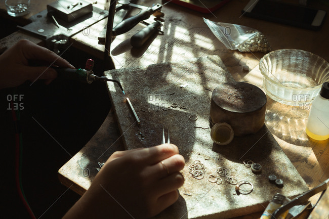 Close-up of jewelry designer working in workshop