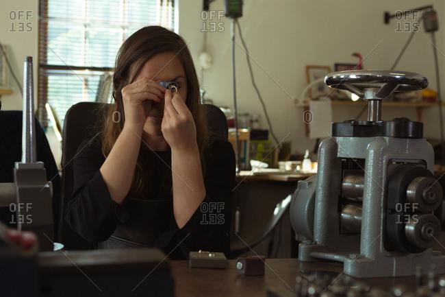 Female jewelry designer working in workshop