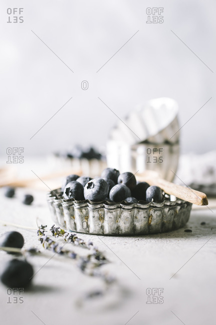 Still life of blueberries in vintage bakeware