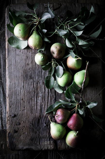 Still life of pears on a wooden cutting board