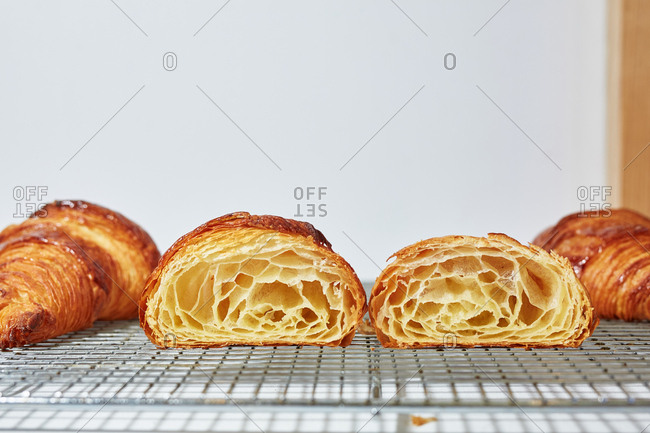 Close-up of freshly baked croissant cut in half