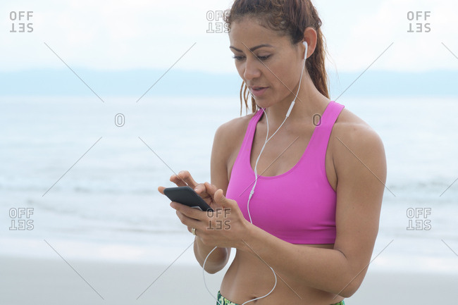 Woman listening music from her smartphone
