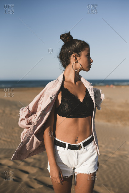 Fashionable teenage girl on the beach