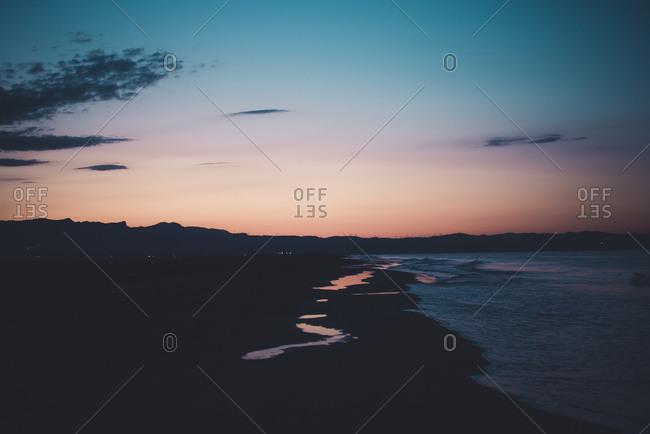Spain, coast at sunset