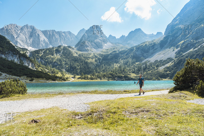Austria, Tyrol, Man hiking at Seebensee Lake