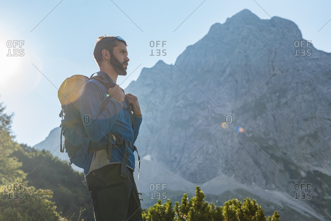 Austria, Tyrol, Hiker with backpack hiking in the mountains