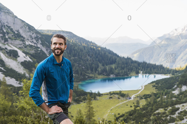 Austria, Tyrol, Hiker taking a break in the mountains at Lake Seebensee