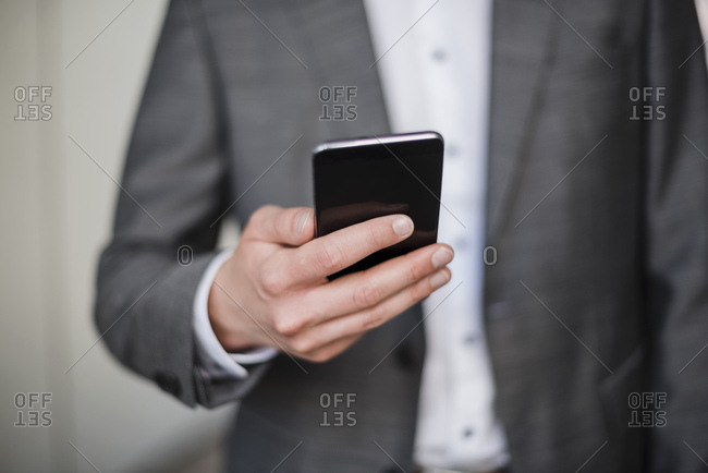 Close, up of businessman holding cell phone
