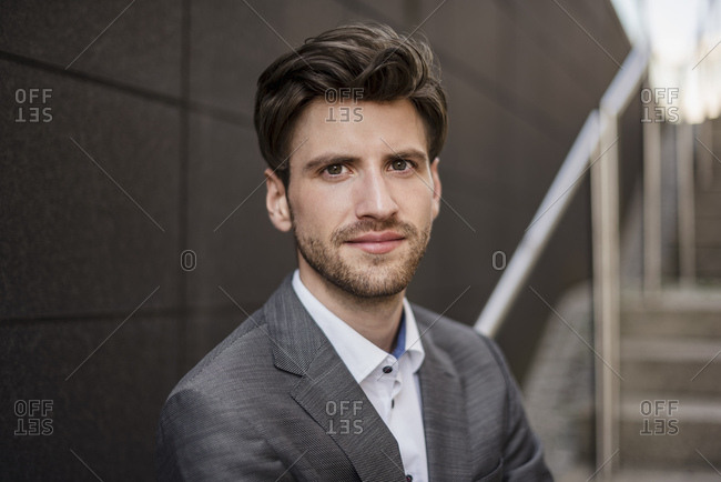 Portrait of confident businessman on stairs