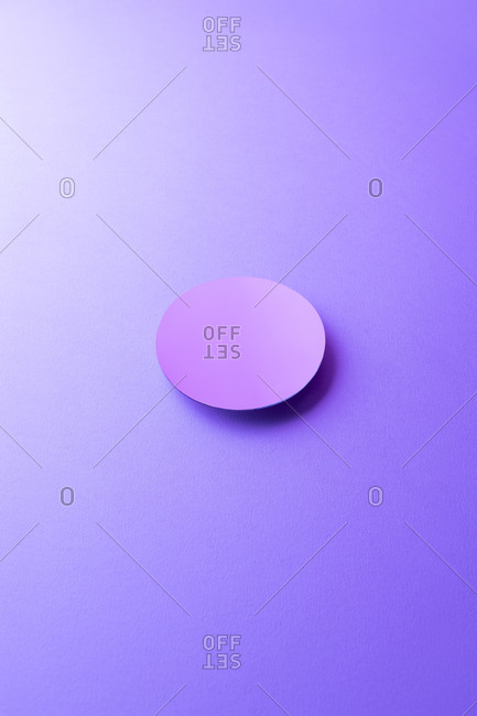 Round shaped mirror on purple ground, 3D Rendering
