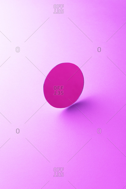 Round shaped mirror on pink ground, 3D Rendering