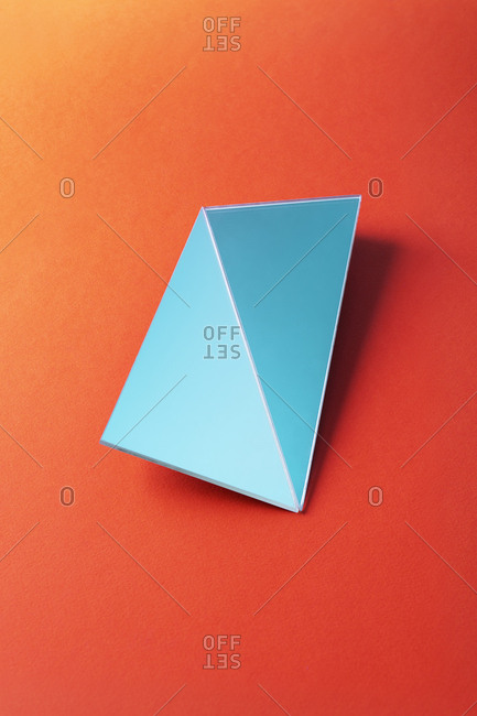 Broken rectangle shaped mirror over red background