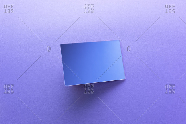 Rectangle shaped mirror on purple background