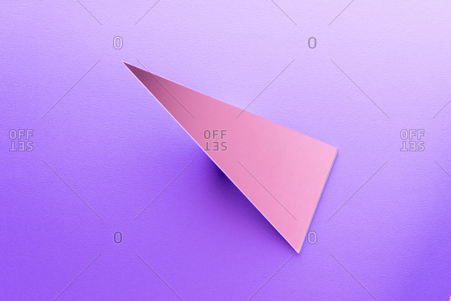 Triangle shaped mirror on purple ground, 3D Rendering