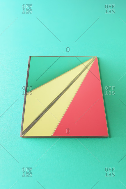 Triangle shaped mirrors over green background