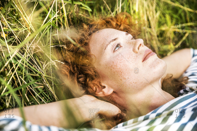 Portrait of young woman relaxing on a meadow