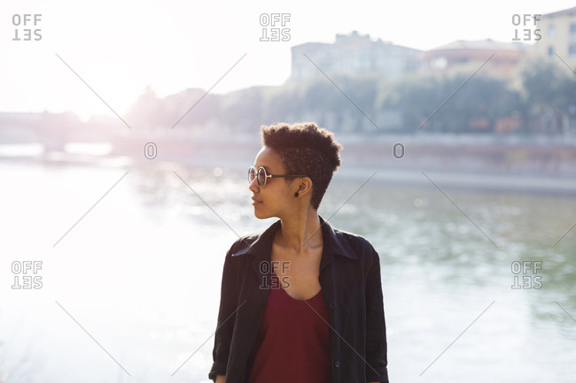 Italy, Verona, young woman in front of Adige River