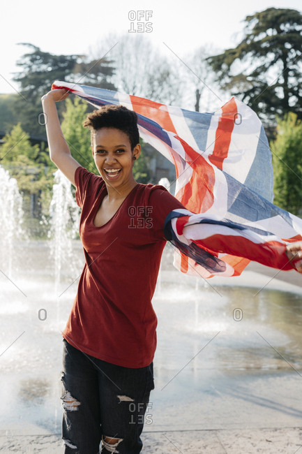Portrait of happy young woman with Union Jack