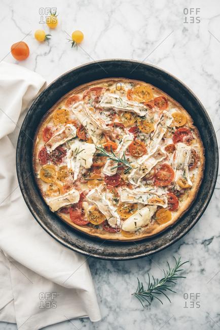 Tomato tart with goat cheese camembert, mustard and rosemary