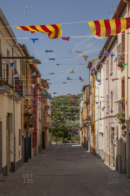 Spain, Catalonia, alley with Catalonian flags