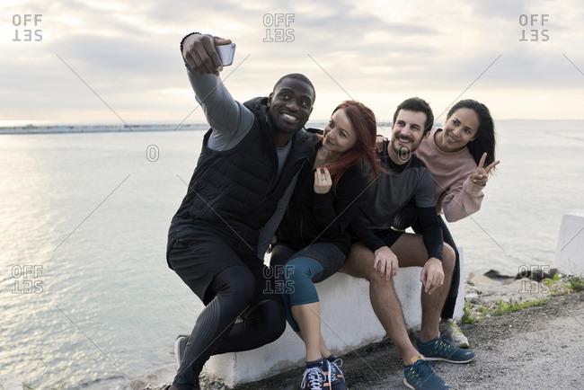 Group of sportspeople taking a selfie