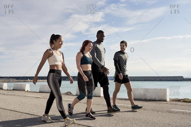 Group of sportspeople walking - Offset