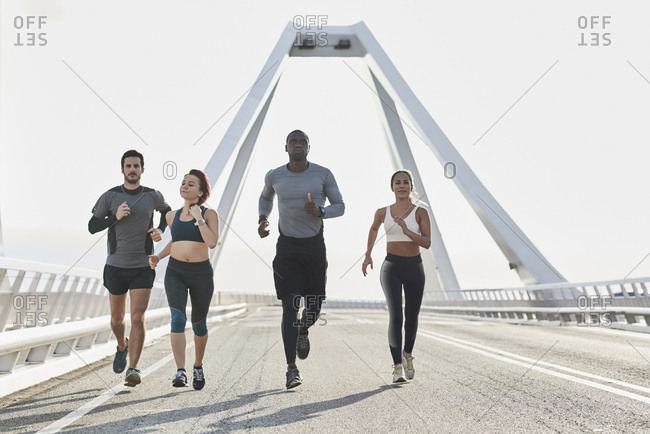 Group of sportspeople jogging - Offset