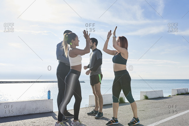 Group of sportspeople, motivating themselves
