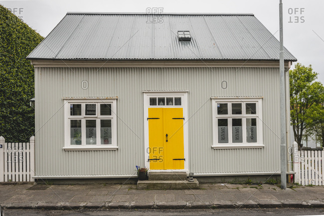 Iceland, Reykjavik - June 2, 2018: House with yellow door