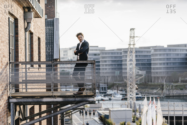 Pensive businessman standing on balcony