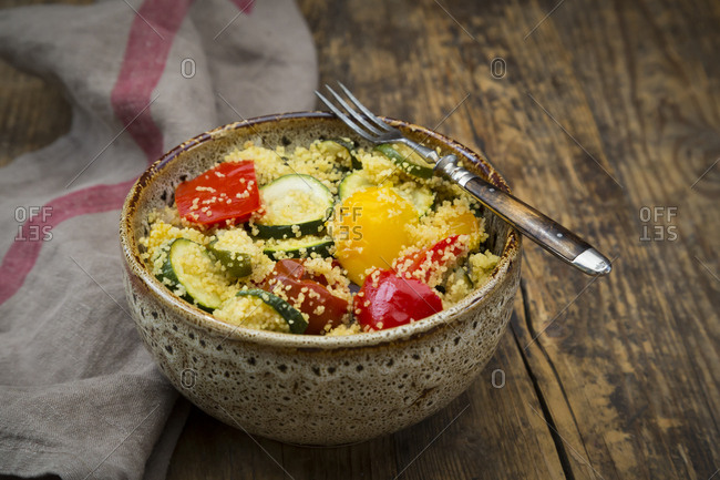 Bowl of oven vegetables with couscous
