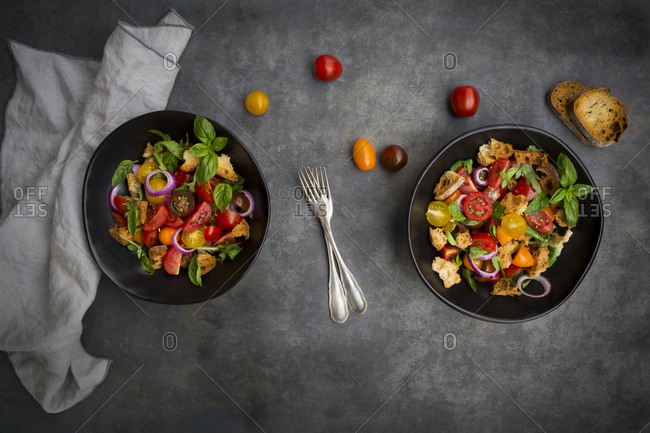Panzanella made of roasted Ciabatta, rocket, red onions, tomatoes and basil