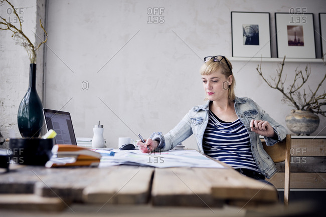 Woman working at desk in a loft