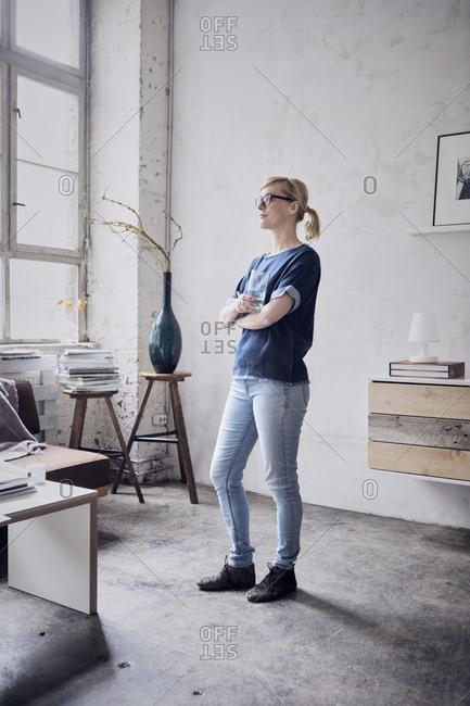 Woman standing in a loft