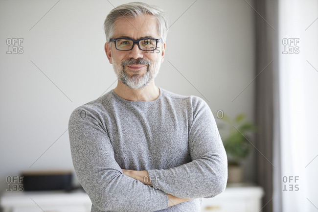 Portrait of content mature man at home
