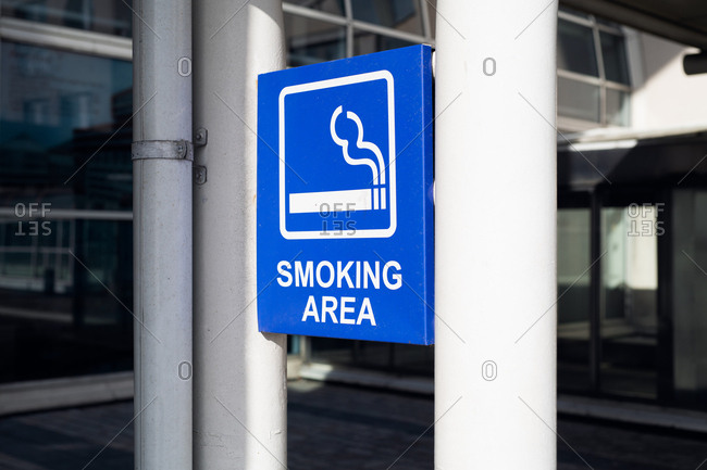 Sign designating smoking area outside of building