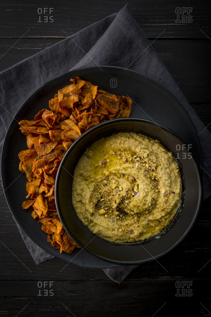 Hummus with carrot chips shot overhead