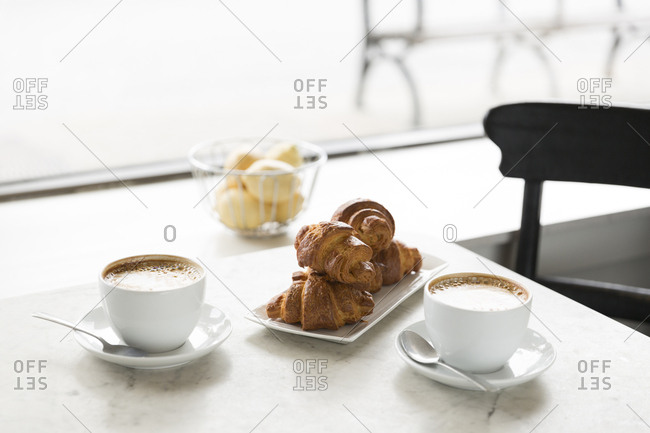 Gluten free croissants and cappuccinos in a cafe