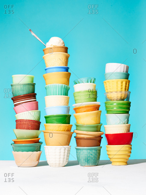 Colorful vintage dessert dishes stacked in a row