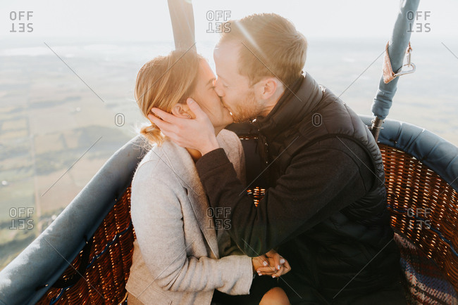 Newly engaged couple in hot air balloon