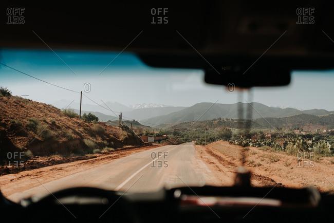 Atlas Mountains, Morocco - April 30, 2014: Car on the road through Atlas Mountains