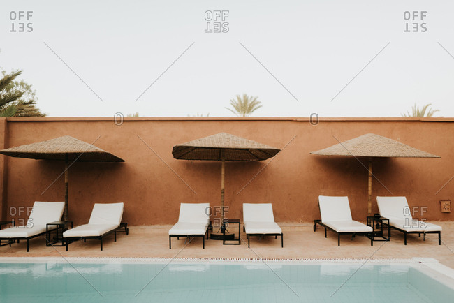 Sun loungers by hotel pool, Douba, Morocco
