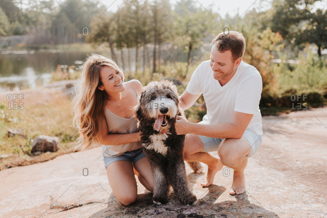 Couple with pet dog, Algonquin Park, Canada