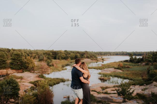 Couple enjoying view of river, Algonquin Park, Canada
