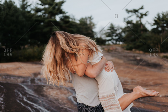 Couple hugging in Algonquin Park, Canada
