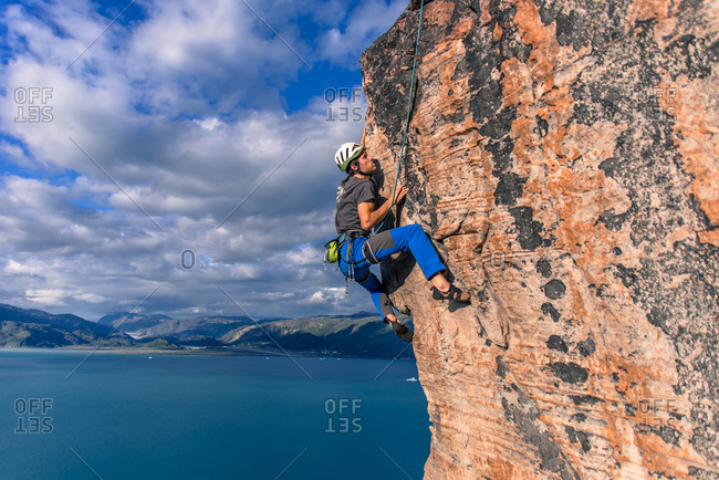 Man rock climbing, Narsaq, Vestgronland, South Greenland