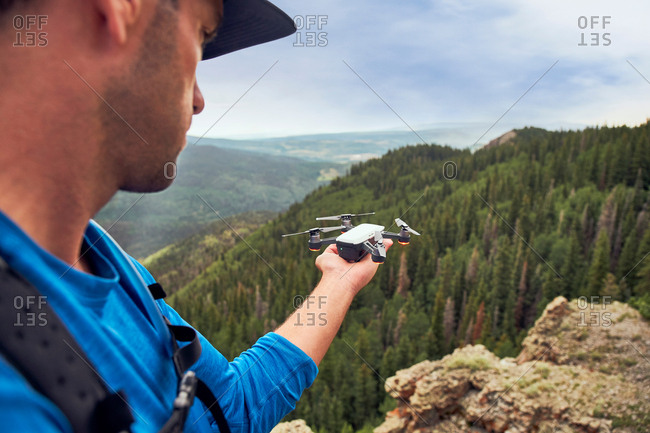 Hiker on mountain peak, Mount Sneffels, Ouray, Colorado, USA